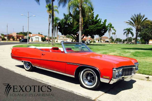Red Buick peep interior la car rental diagonal view