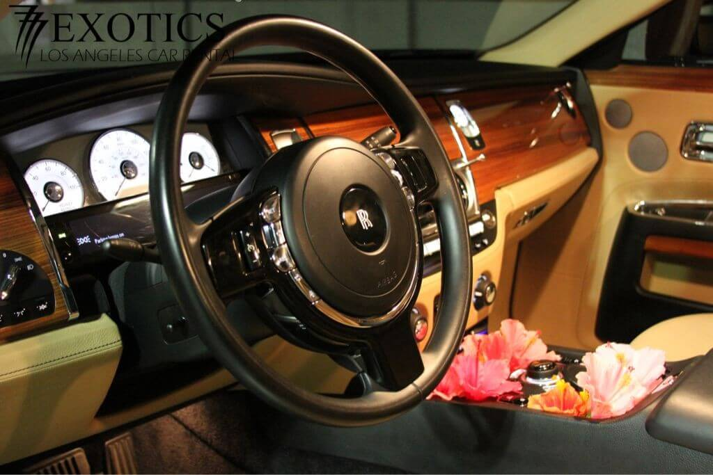 Steering side view of Black rolls royce ghost