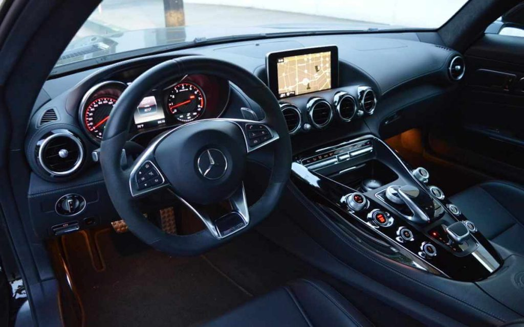 Steering and dashboard view of Mercedes Benz Hot Car rental