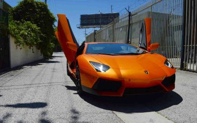 Front view of Lamborghini Aventador Orange car door up