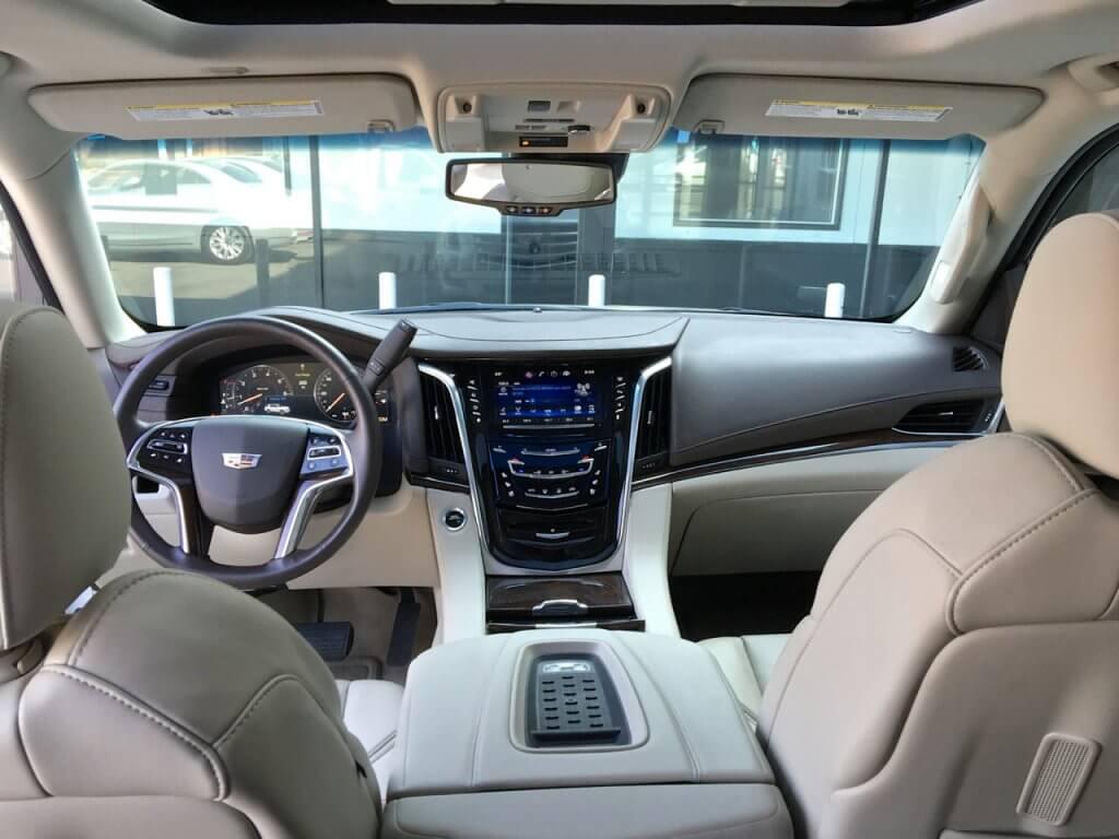 escalade-interior-leather-seats-and-steering-wheel-luxury-suv