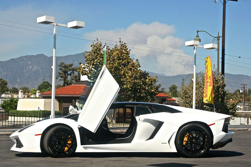 Lamborghini Aventador White side view doors open LA rental