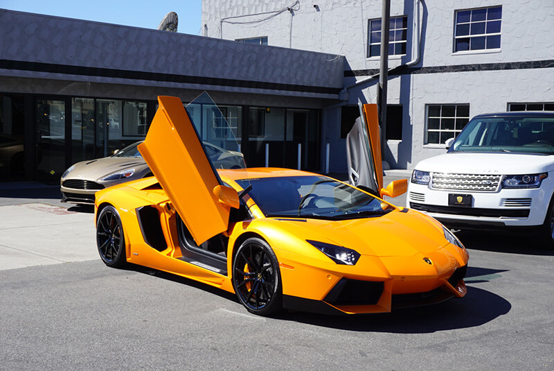 Lamborghini Aventador Light Orange diagonal front view doors open beverly hills rental