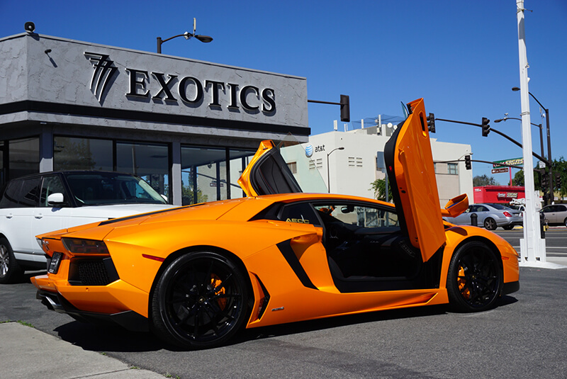 Lamborghini Aventador Light Orange doors open beverly hills rental