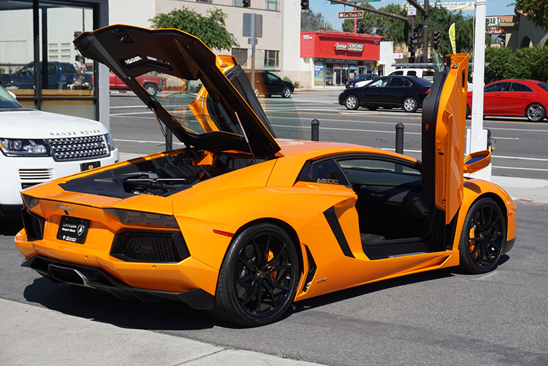 Lamborghini Aventador Light Orange doors open back view LA rental